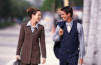 portrait of businesswoman and a businessman walking