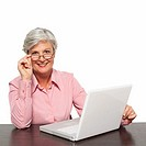 Close-up of mature woman working on laptop