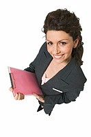 Elevated view of young businesswoman holding files