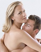 Bare chested young couple holding each other