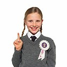 schoolgirl gesturing the number one wearing a rosette saying number one