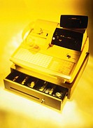 toned high angle view of a cash register with drawer open