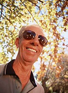 Low angle view of an elderly man wearing sunglasses