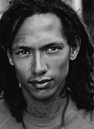 close-up of a young man with dreadlocks (black and white)