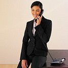 Front view of businesswoman using a telephone