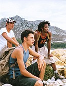 side profile of three young men resting during a hiking trip