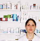 portrait of a chemist standing in a drugstore