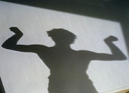 shadow of a man flexing his biceps