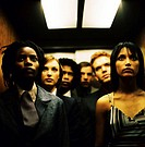 portrait of a people standing in a dark elevator