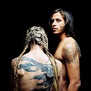 rear view of a topples couple with tattoos on their back