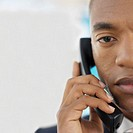 Front view portrait of businessman talking on telephone
