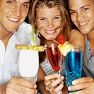 Front view portrait of three young people holding cocktails