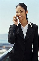 Front view portrait of businesswoman talking on mobile phone