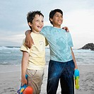 Close-up of two boys holding water guns with arms around each other (10-12)