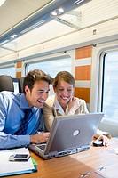 Businessmen working connected to the internet. Passenger. AVE, Tren de Alta Velocidad, Zaragoza, Aragón. Spain.