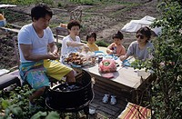 An Asian family dining at the garden