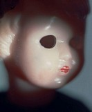 Face of a scary doll