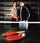 Close-up of two table tennis rackets and a tennis ball