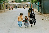 Mother with her two children in La Isla, Valparaiso slums, Chile 1999