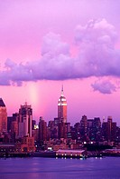 Rainbow and clouds, Mid-town skyline, Manhattan, New York, USA.