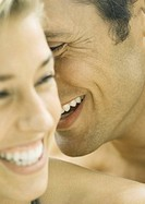 Couple laughing, close-up of faces