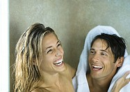 Couple drying off and laughing