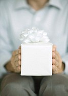 Man holding out gift