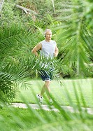 Mature man jogging on walkway