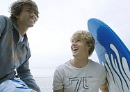 Young men with surfboard