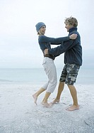 Young couple dancing on beach