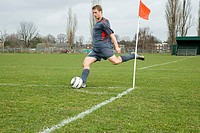 Footballer taking a corner kick (thumbnail)