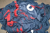 Pile of football uniforms