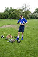 Footballer changing in the park