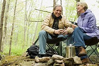 Mature couple camping in forest