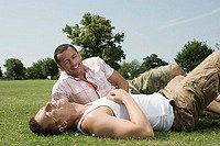 Gay couple sitting in park