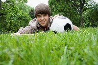 Teenage boy with a football in park (thumbnail)
