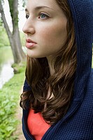 Teenage girl wearing a hooded top