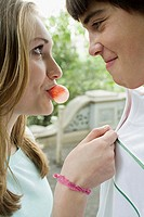 Young couple with bubble gum