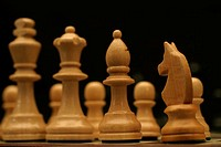 Front view of some wooden chessmen.