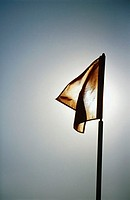 Flag, sun in background