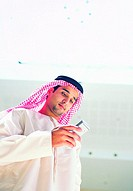 Arab man using mobile phone (thumbnail)