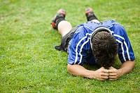 Athlete Lying Down on Field