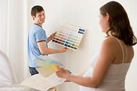 Couple choosing colours for nursery