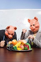 Businesspeople in pig masks with plastic food