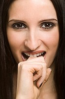 Woman biting her finger