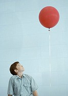 Boy looking up at balloon