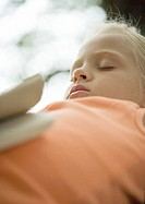 Girl sleeping with book on stomach