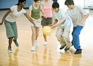 High school students playing basketball in school gym