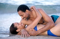 romantic couple embracing on the beach