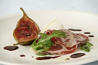 Cured ham, coppa with marinated figs